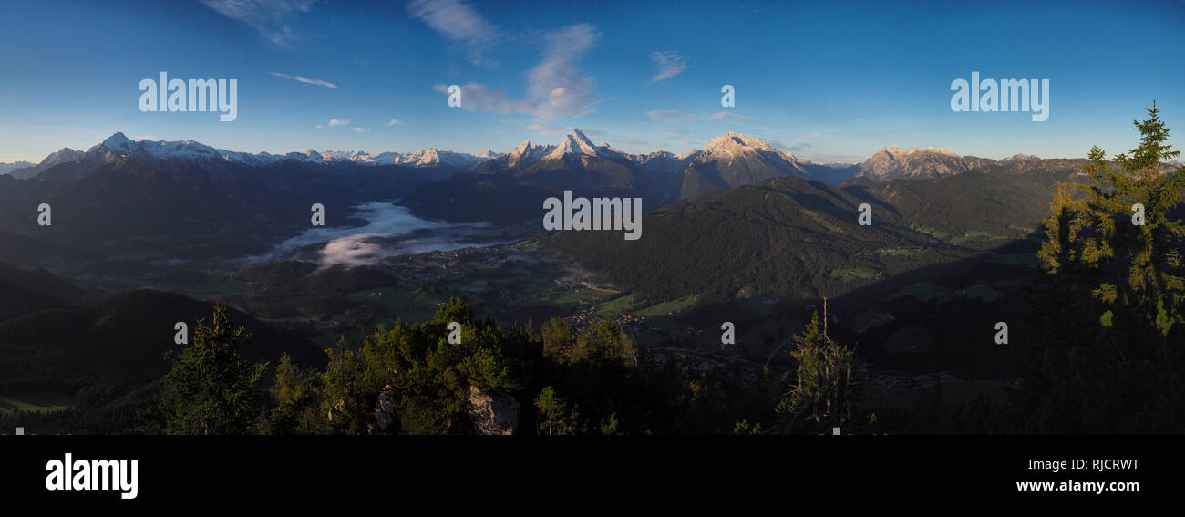 panoramic view of  Berchtesgaden alps and national park, with famous peaks Hoher Goell, Kahlersberg, Hochkoenig, Funtenseetauern, Watzmann and Hochkal Stock Photo
