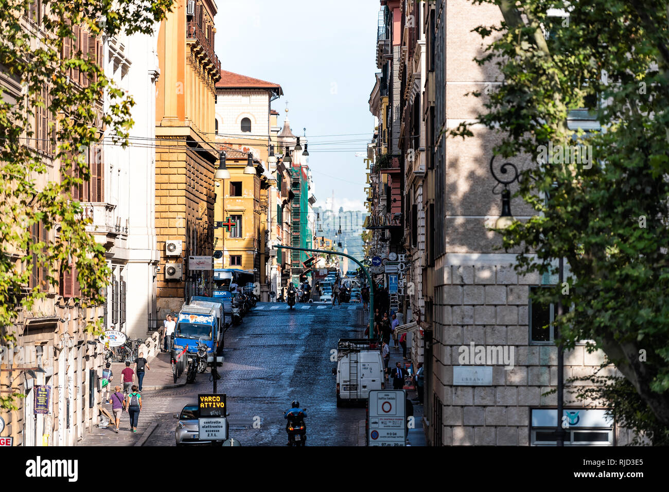 Rome, Italy - September 4, 2018: Streetscape cityscape of city town road Via Urbana sign and Piazza Esquilino park square framing of street in Rioni M Stock Photo