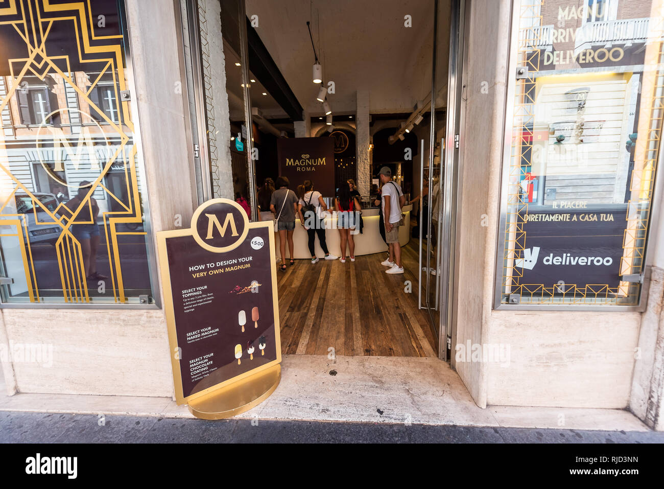 Rome, Italy - September 5, 2018: Italian street outside in city day storefront for Magnum M ice cream gelato store - Stock Image