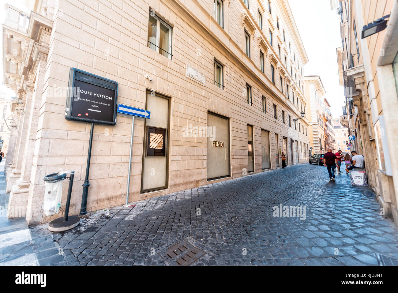 Rome, Italy - September 5, 2018: Italian street outside in historic city sunny day and sign for Louis Vuitton store on Via del Leoncino and Tomacelli  Stock Photo