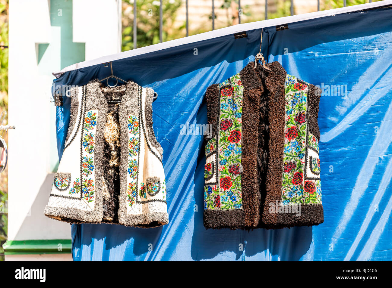 Kyiv, Ukraine Andriyivskyy Uzviz Descent with vendors selling souvenirs vest wool jacket traditional costume in market stall culture clothes on displa - Stock Image