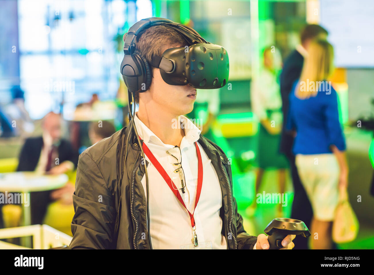 2d0a94d3f7d Young man playing video games virtual reality glasses. Cheerful man having  fun with new trends technology - Gaming concept.