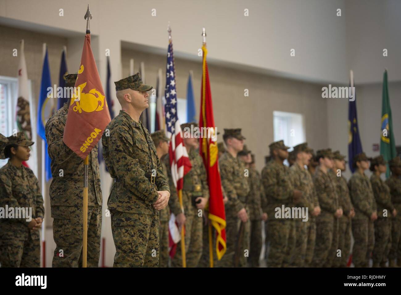 Marines stand in formation awaiting the beginning of a