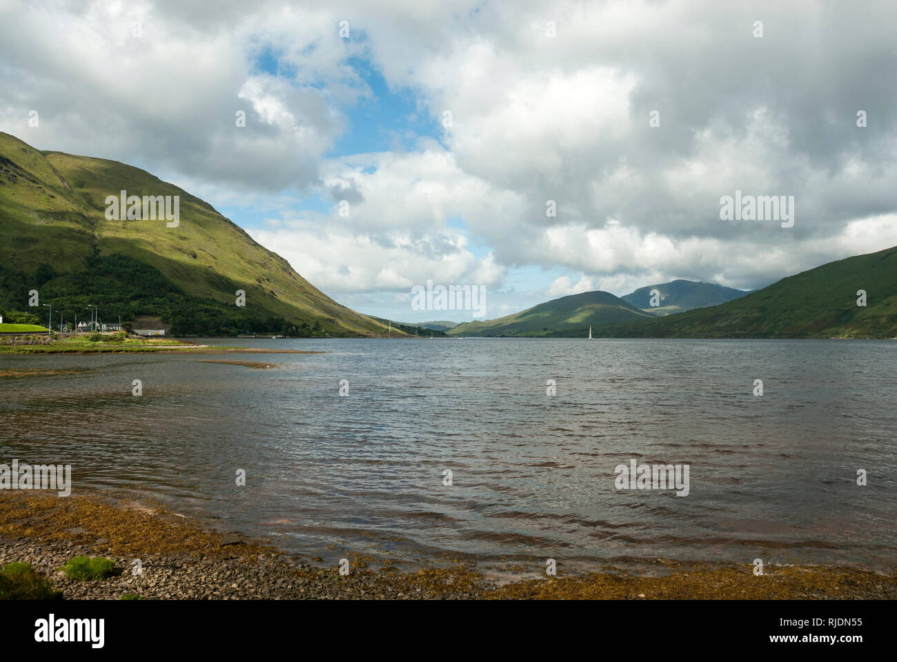 Fin Lough or Bright Lake in Co Mayo, Ireland with the salmon fishing and farming lake in the foreground and the Sheefry hills behind. - Stock Image