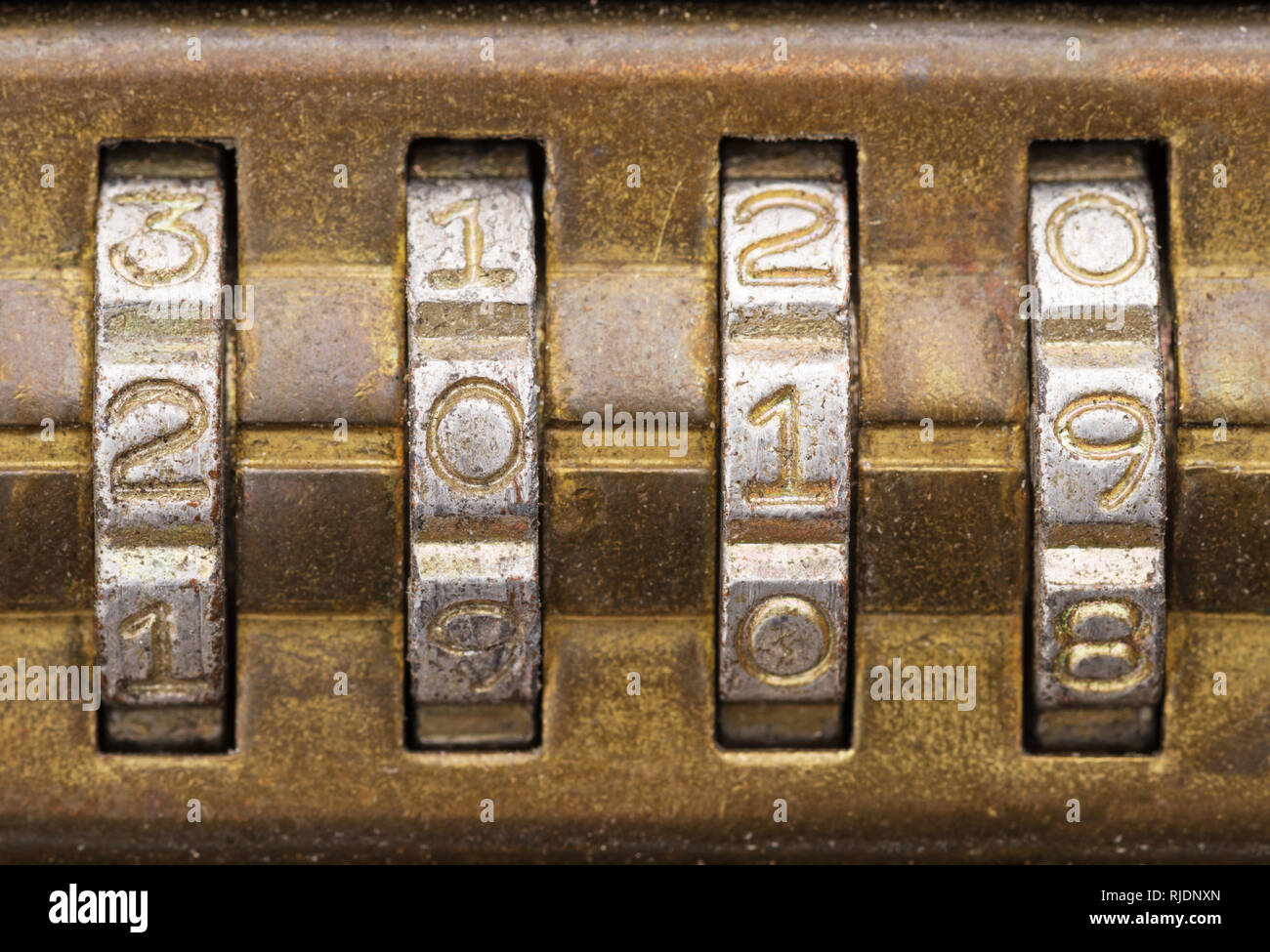 closeup of 2019 on old brass combination lock dials - Stock Image