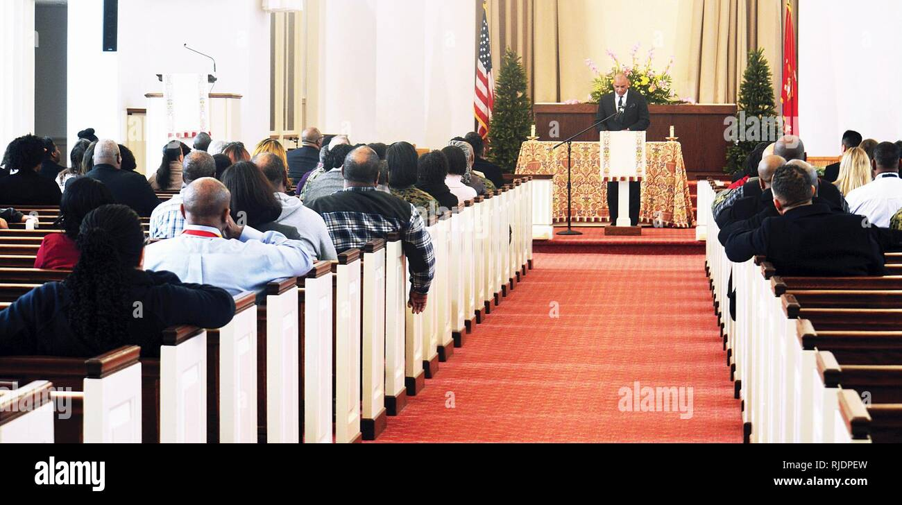 Pastor Derek Grier of Grace Church, Dumfries, Virginia,  stands at the pulpit at the Marine Memorial Chapel aboard Quantico as members of the base community listen attentively about the  legacy of Rev. Martin Luther King Jr. and what they can do to honor his dream. - Stock Image