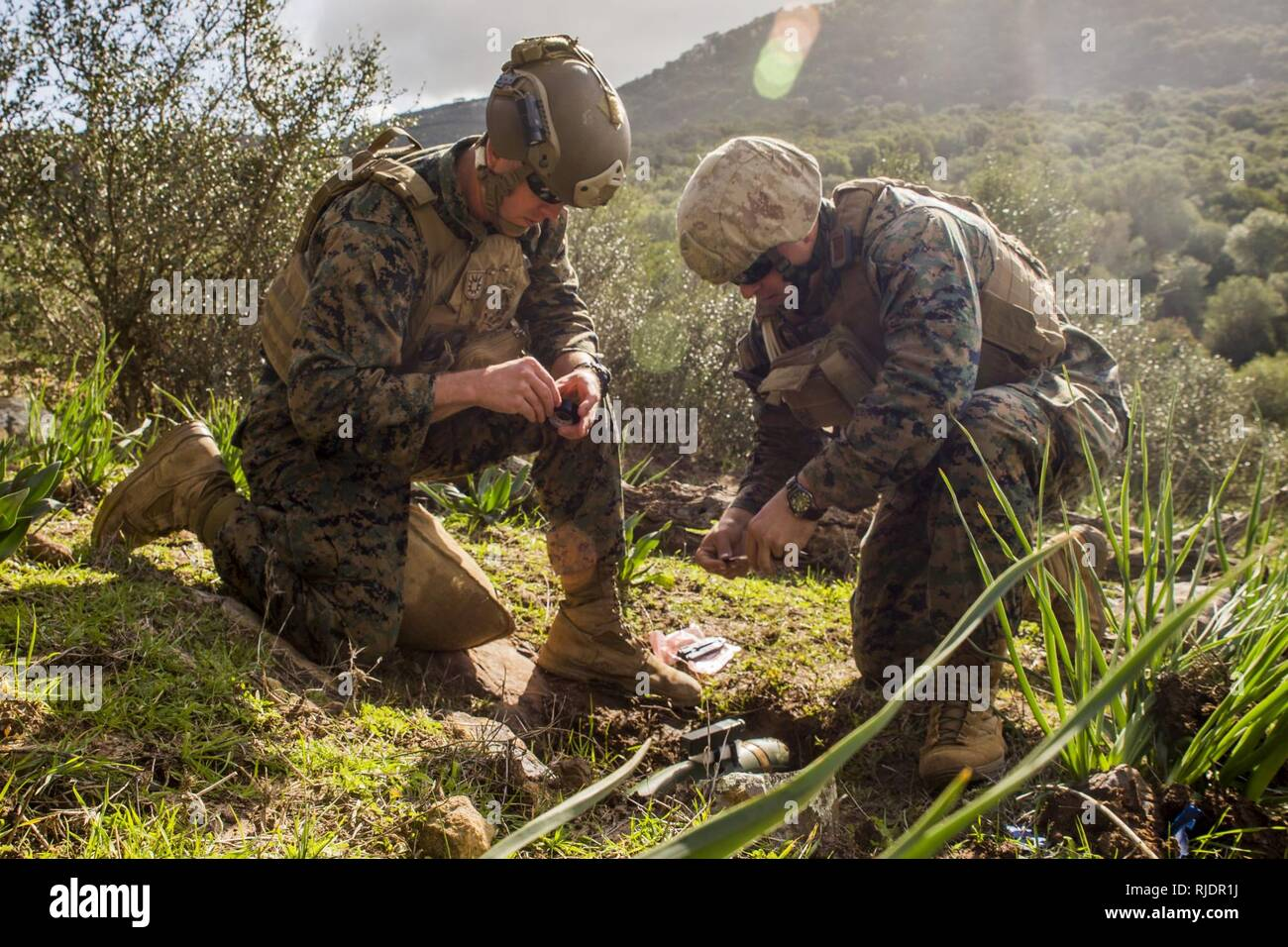 U.S. explosive ordnance disposal Marines with Special Purpose Marine Air-Ground Task Force-Crisis Response-Africa prepare ordnance for detonation at Sierra del Retin, Spain, Jan. 18, 2018. SPMAGTF-CR-AF is deployed to conduct limited crisis-response and theater-security operations in Europe and North Africa. - Stock Image