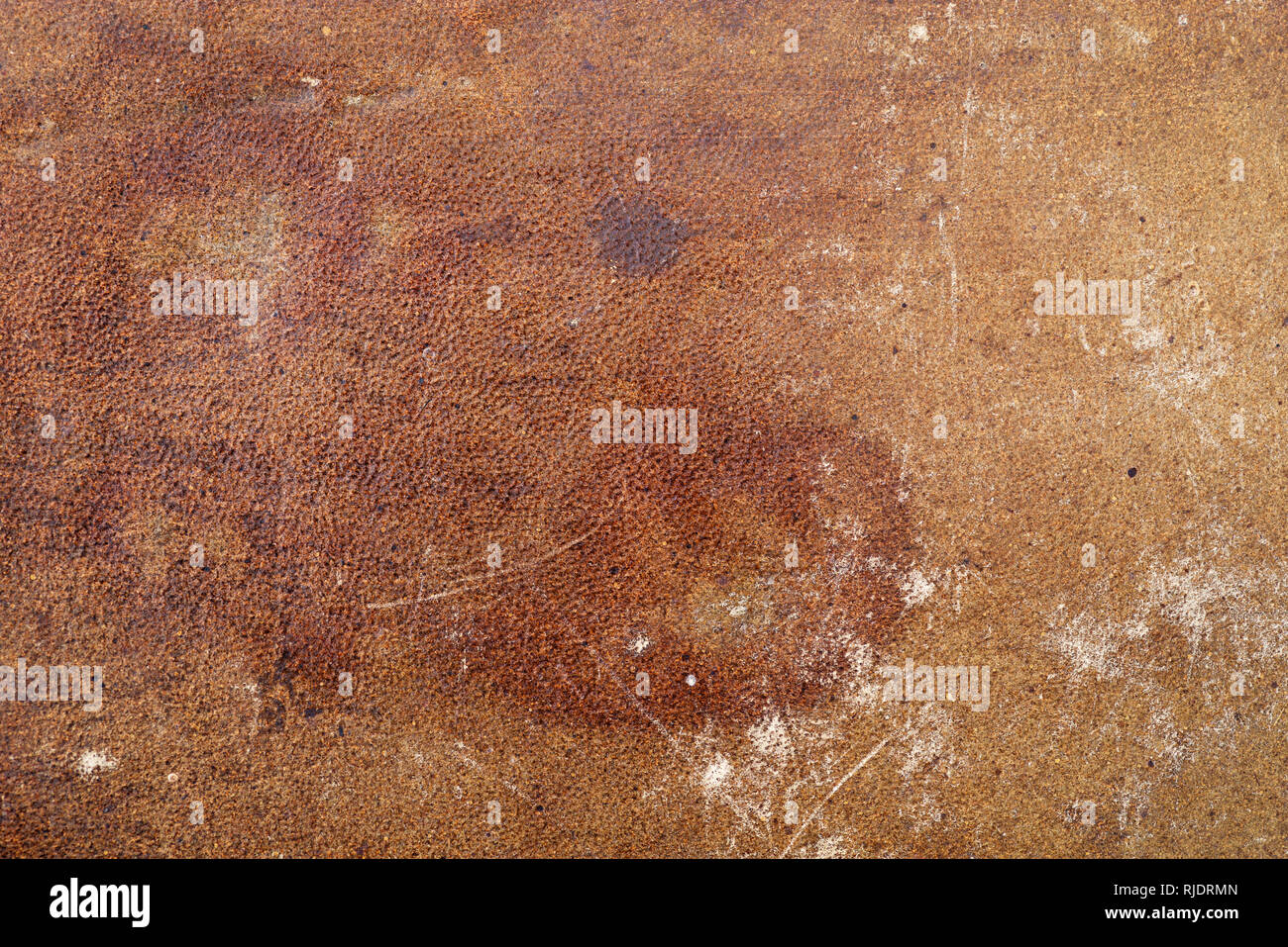old distressed stained and scuffed leather background texture - Stock Image