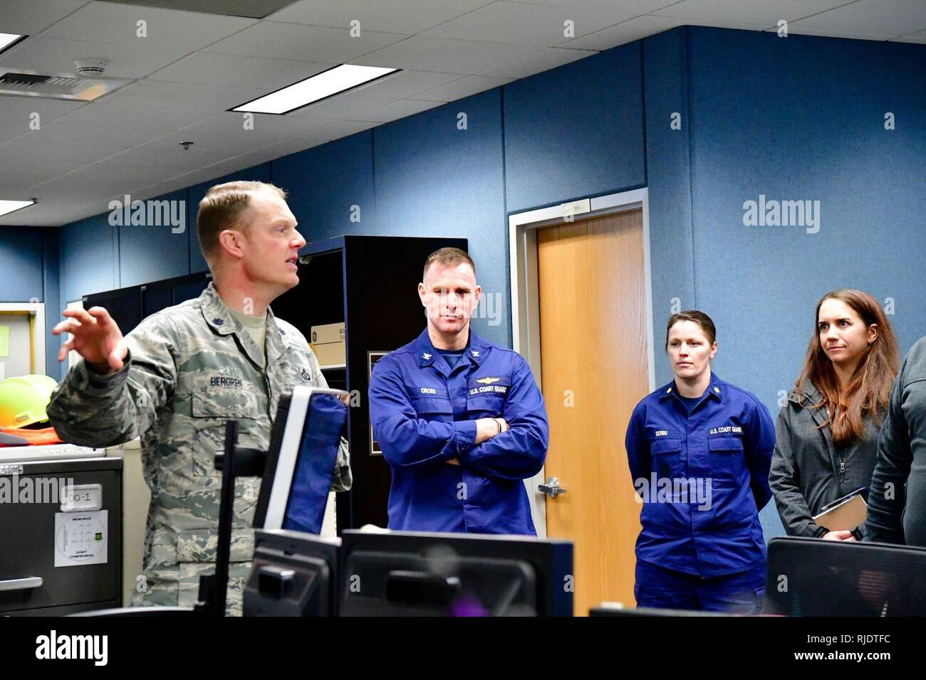 Lt. Col. Brian Bergren, 225th Air Defense Squadron director of operations, discusses lessons learned from Hurricane Harvey recovery efforts with Capt. Sean Cross, U.S. Coast Guard 13th District chief of incident management, and Lt. Cmdr. Brook Serbu, U.S. Coast Guard 13th District command center chief. - Stock Image