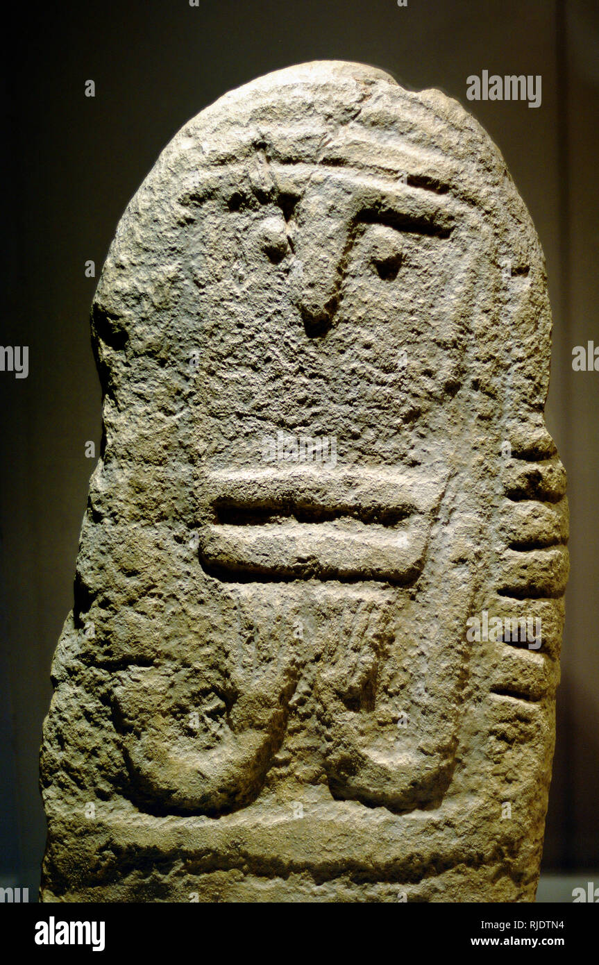 Neolithic Stéle (2500BC) or Monument with Bas-Relief Face Carving from Maison Aube, Montagnac Gard France - Stock Image