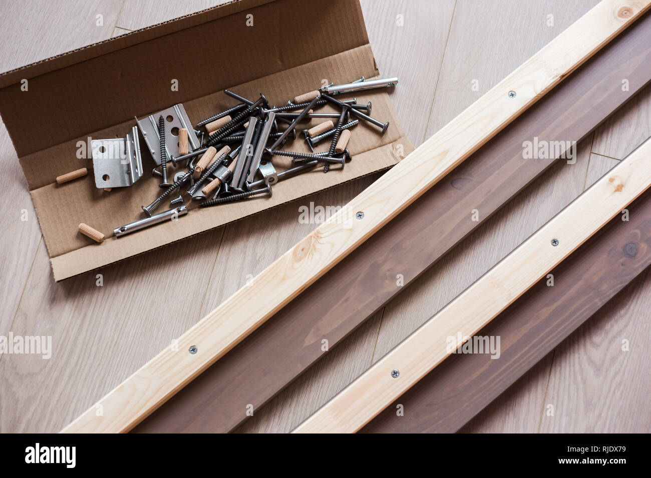 Furniture Fittings Screws And Other Parts In Open Craft Box Lying