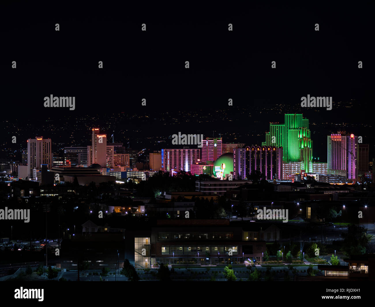 City Of Reno cityscape at night with multicolored hotels and casinos. - Stock Image
