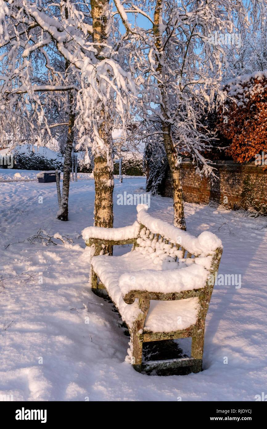 Snowy seat, Upper Wield, Hampshire, UK - Stock Image