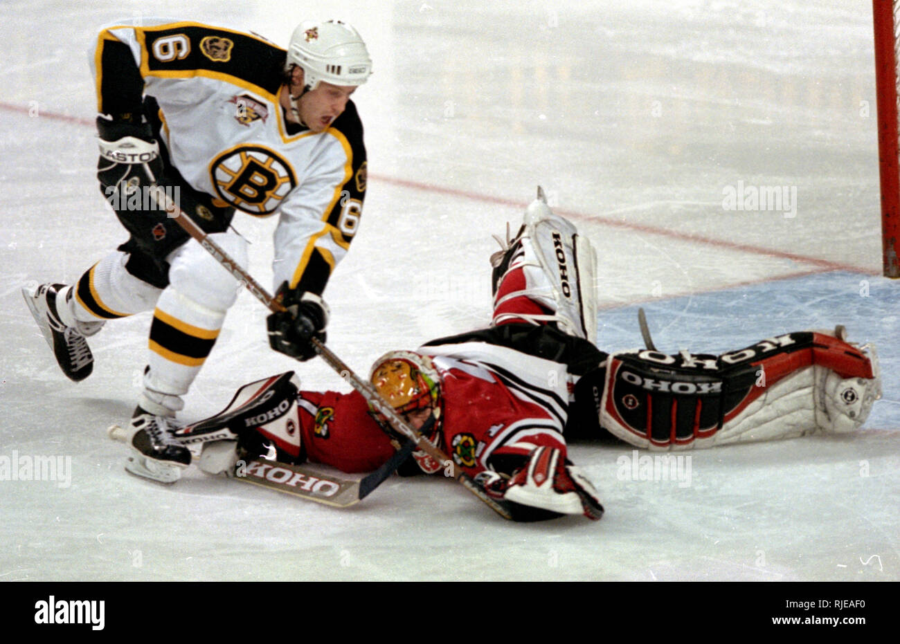 Chicago Black Hawks goalie Jocelyn Thibault makes the save on Boston Bruins Joe Thornton in game action at the Fleet Center in Boston Ma USA March 25,1999 photo by bill belknap Stock Photo