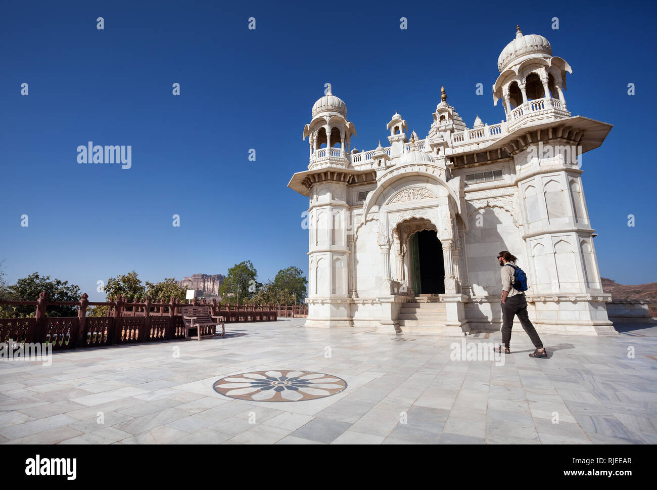 JODHPUR, RAJASTHAN, INDIA - MARCH 09, 2015: Foreign tourist walking near Royal Cenotaph memorial from white marble – one of the famous place in Jodhpu - Stock Image