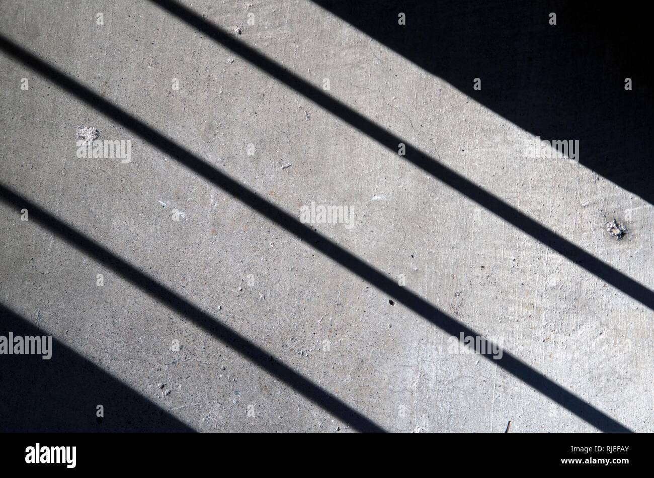 Sunlight created these shadows on the stairs in my apartment in San Rafael, CA. - Stock Image