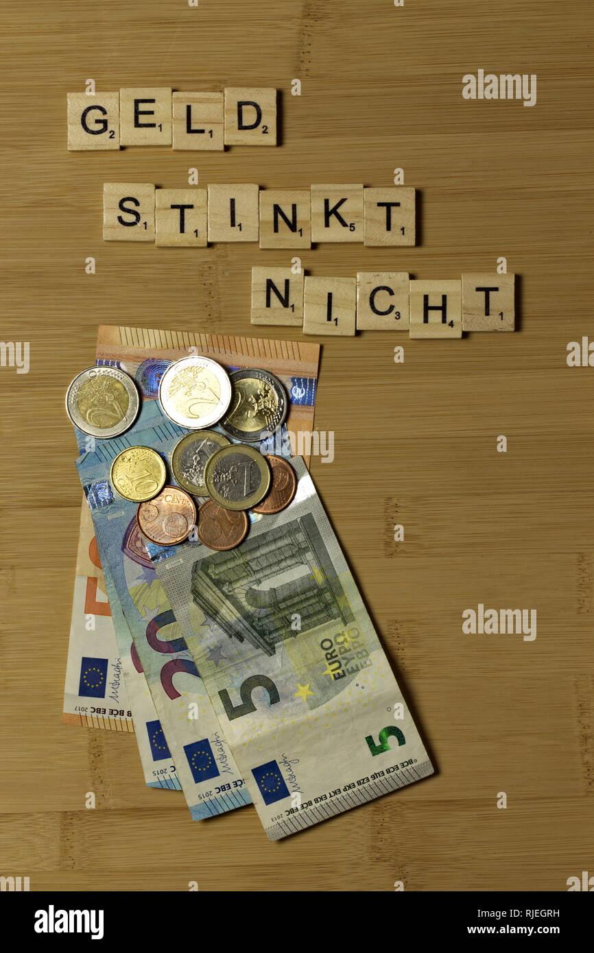 Money doesnt stink, word in german Geld stinkt nicht - Stock Image