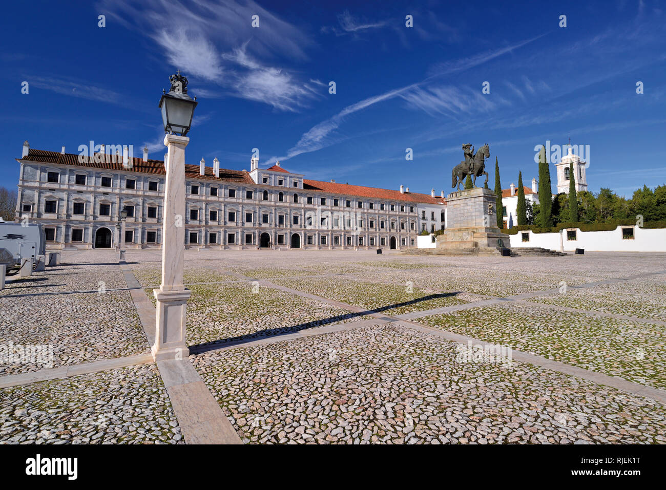 Wide Square with historic palace, equestrian monument and bright light of a sunny day - Stock Image