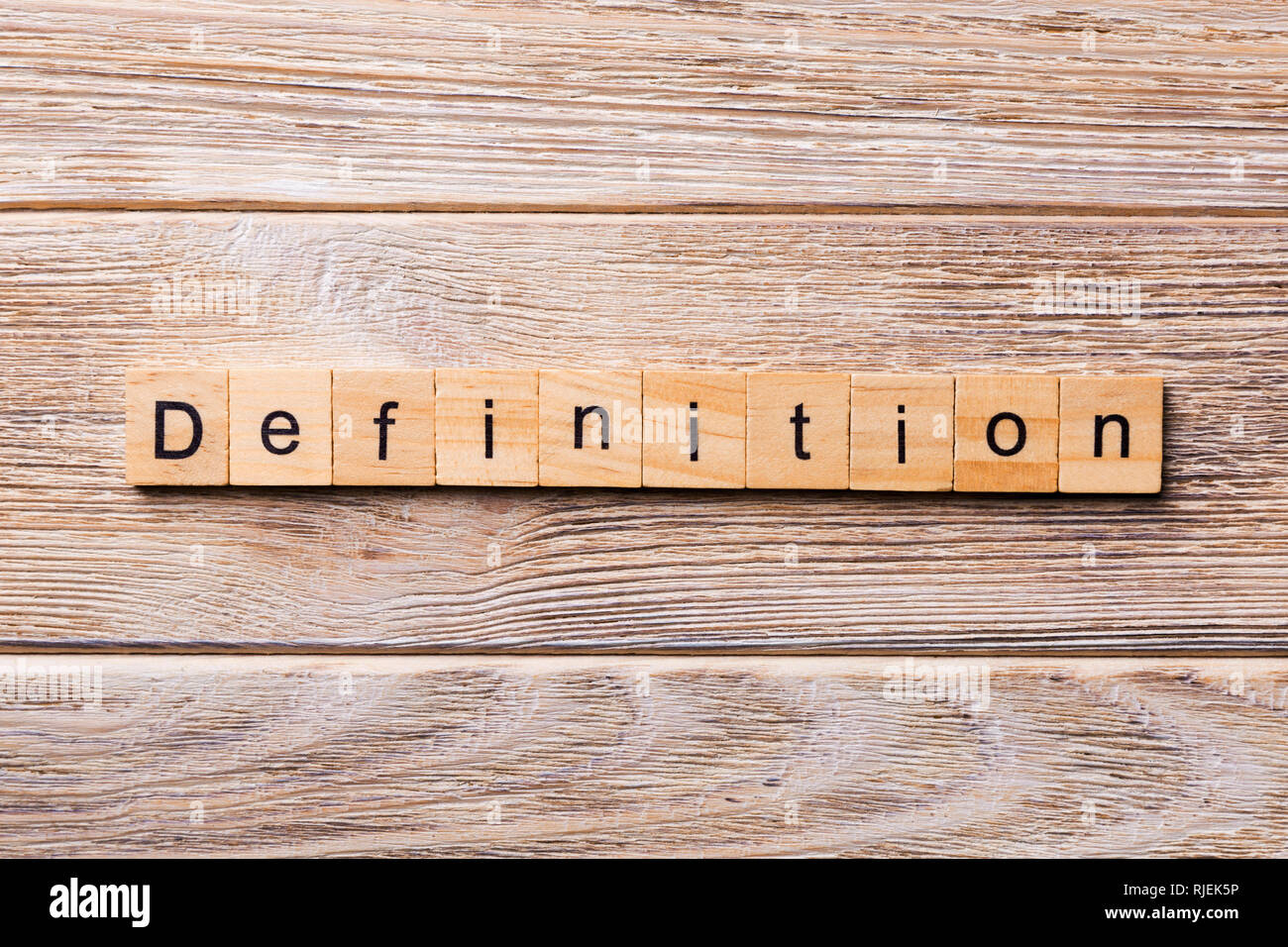definition word written on wood block  definition text on