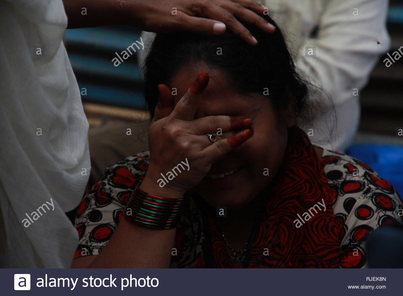 Relatives of the victims mourns the death, in Thane, Mumbai, India on June 21, 2013. The 35-year-old Shakuntala building, situated at Bazarpeth in Mumbra of Thane district collapsed after midnight. At least ten people are feared dead and several people are injured.(Ramesh Nair/ SOLARIS IMAGES) at least 14 injured. (Ramesh Nair/ SOLARIS IMAGES) - Stock Image