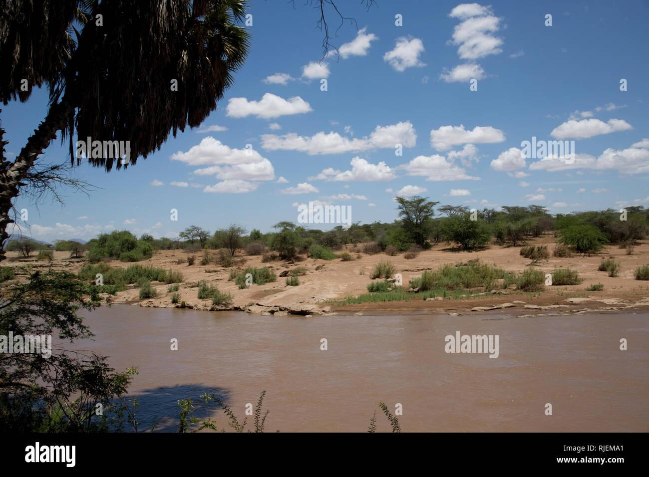 Scenic of Ewaso Ngiro river, blue sky with fluffy clouds, Shaba National Reserve, Kenya - Stock Image