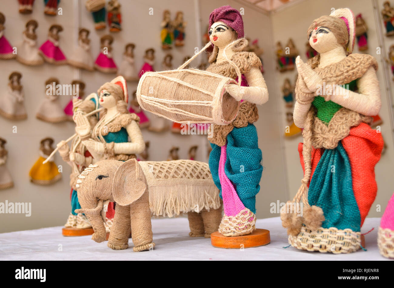 25219eef1da Puppets made out of Jute on display for sale at a handicraft exhibition at  Delhi Haat