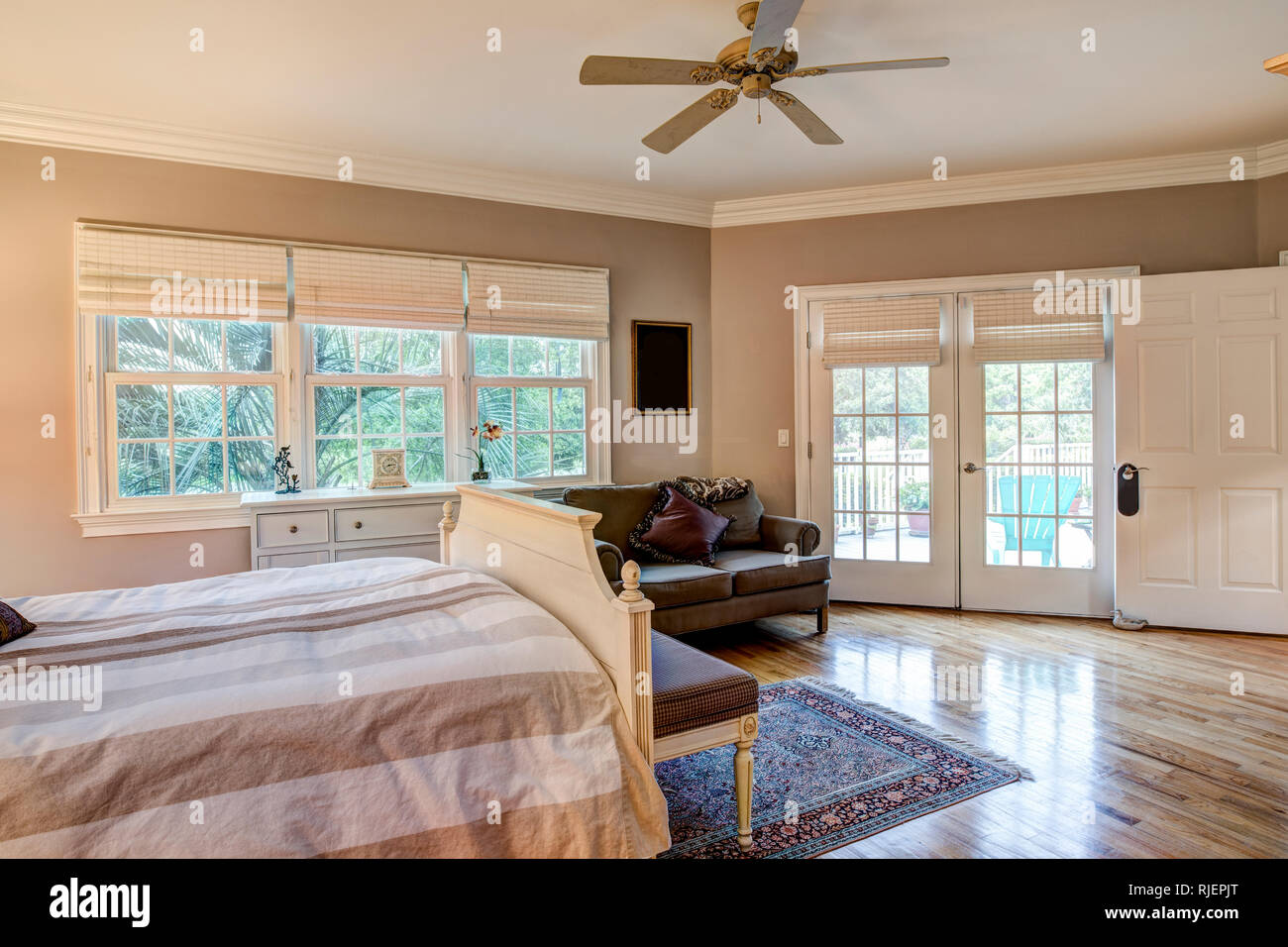 Tasteful Bedroom Interior With Hard Wood Floors And French Doors Stock Photo Alamy