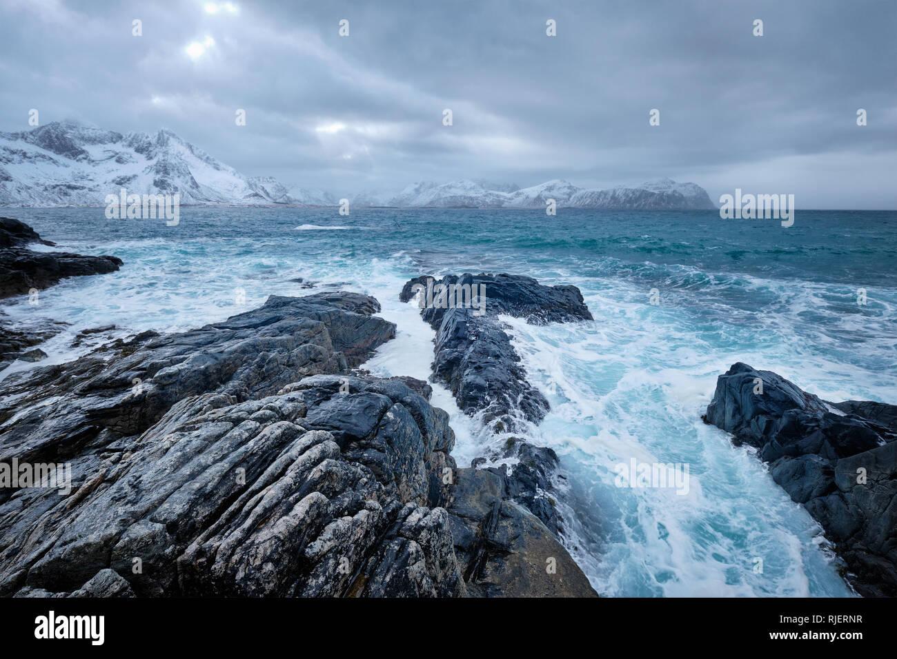 Norwegian Sea waves on rocky coast of Lofoten islands, Norway Stock Photo