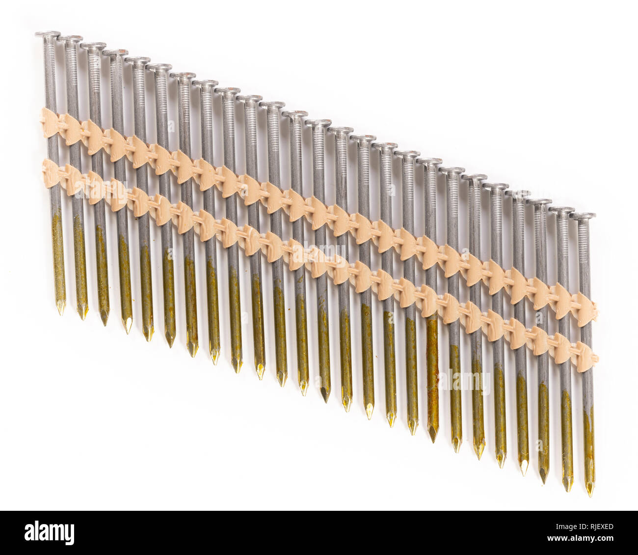 Nail gun nails used in a framing nail gun isolated on a white background. - Stock Image