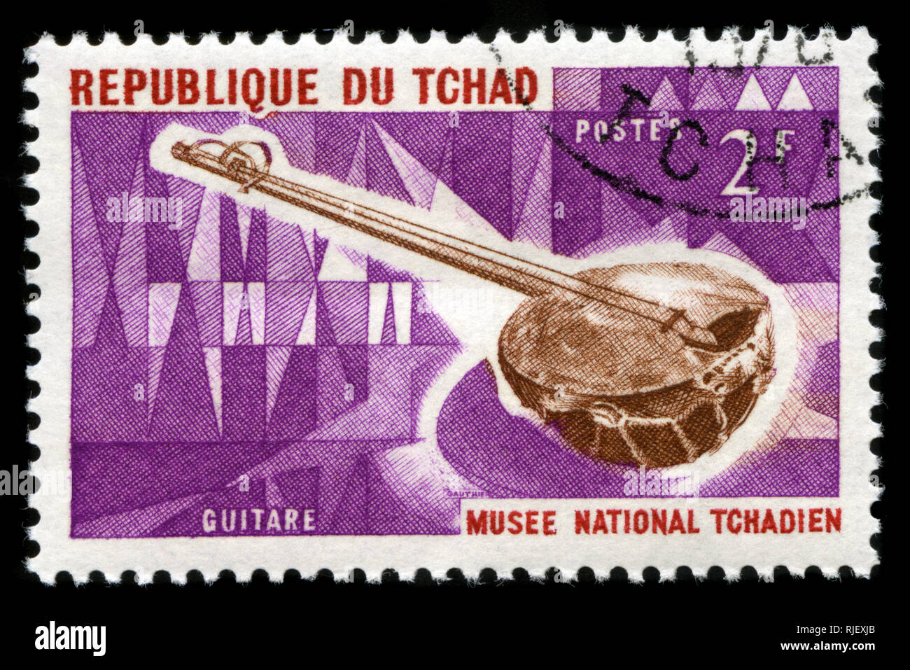 Postmarked stamp from Chad in the Musical instruments series issued in 1965 - Stock Image