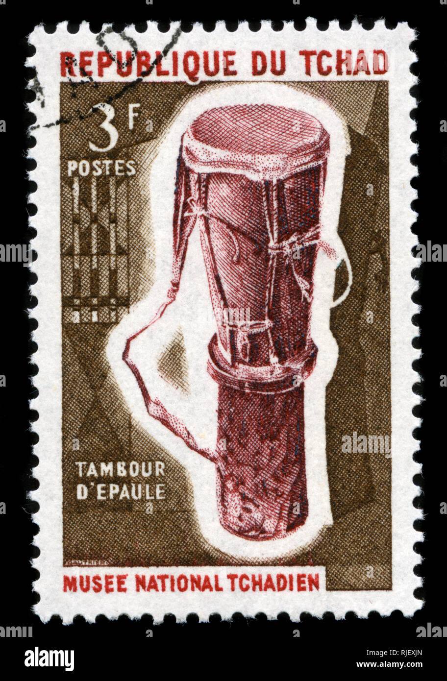 Postmarked stamp from Chad in the Musical instruments series issued in 1965 Stock Photo