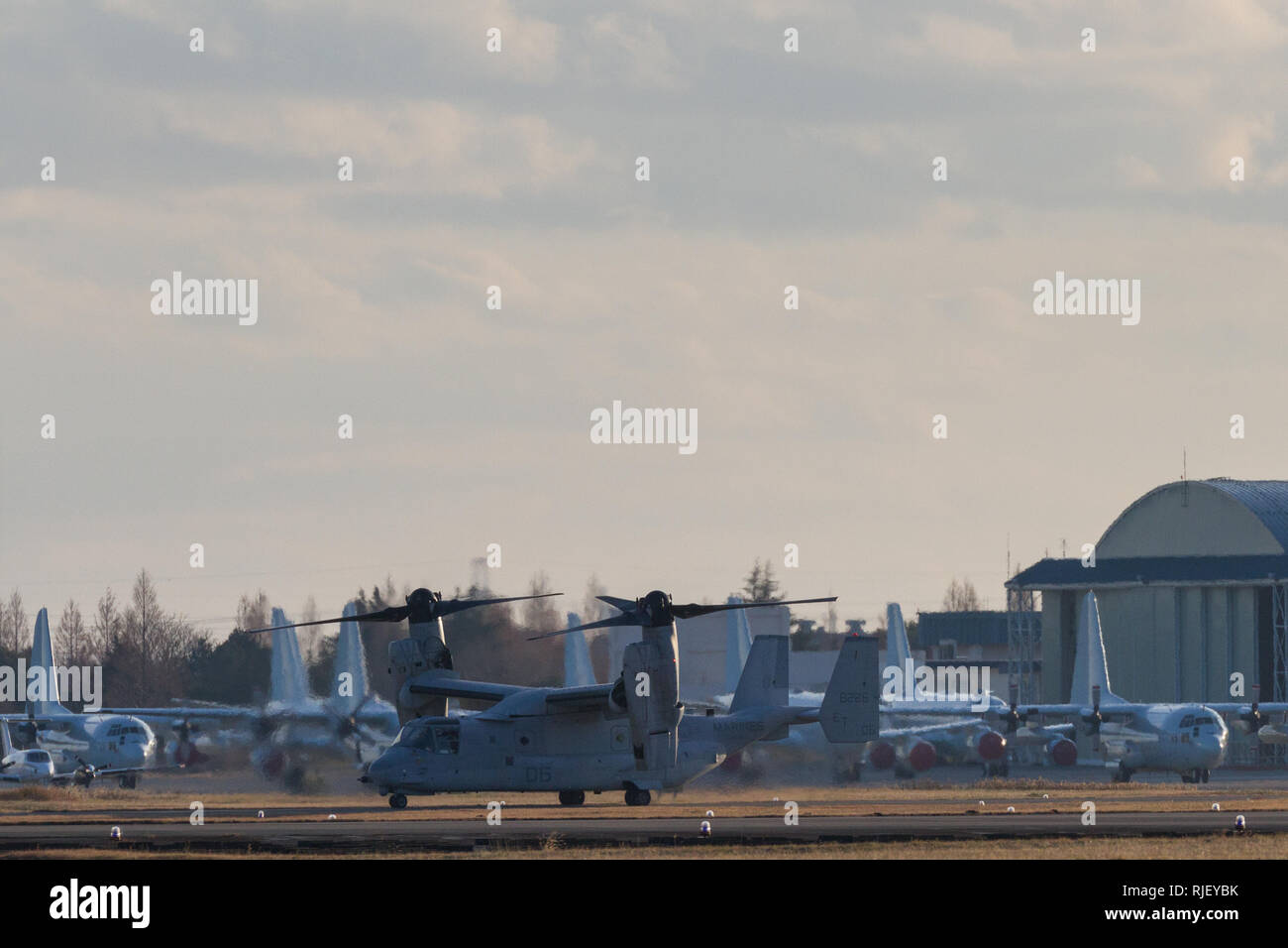 A  Bell Boeing V22 Osprey tilt-rotor aircraft with the US Marines, prepares for take off from Naval Air Facility Atsugi in Yamato, Kanagawa, Japan. Fr - Stock Image