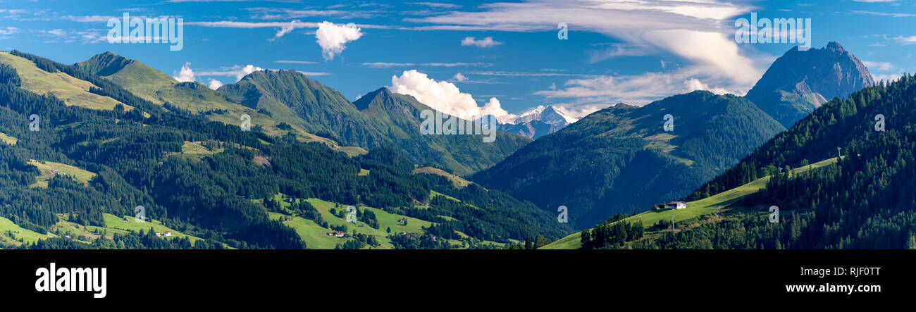 panorama of mountains with mountain pastures in front of Mt. Schneekopf Stock Photo