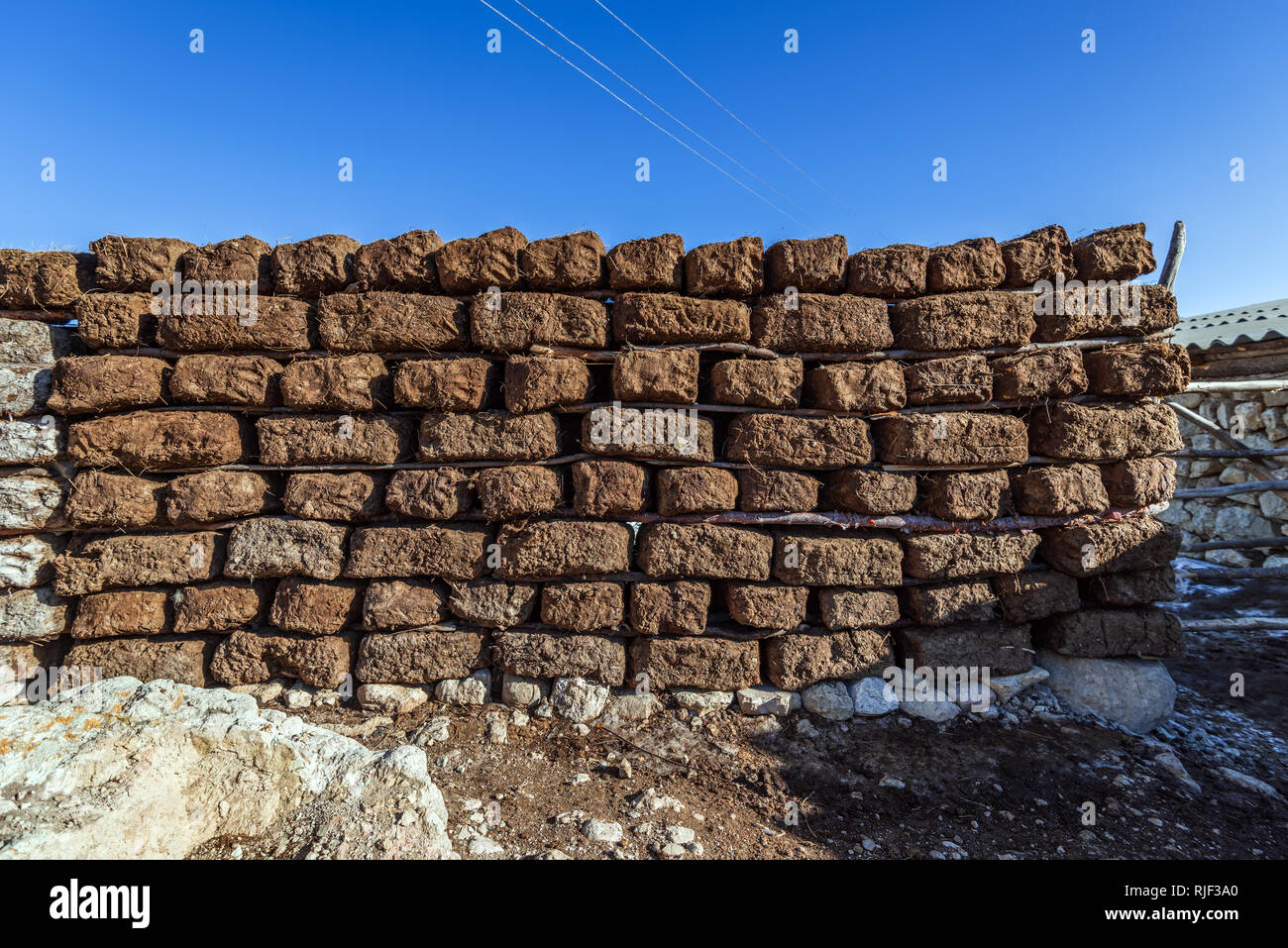 Dried blocks of manure, used for construction and for room heating - Stock Image