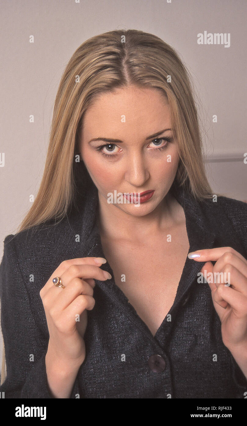 Young woman wearing black top - Stock Image