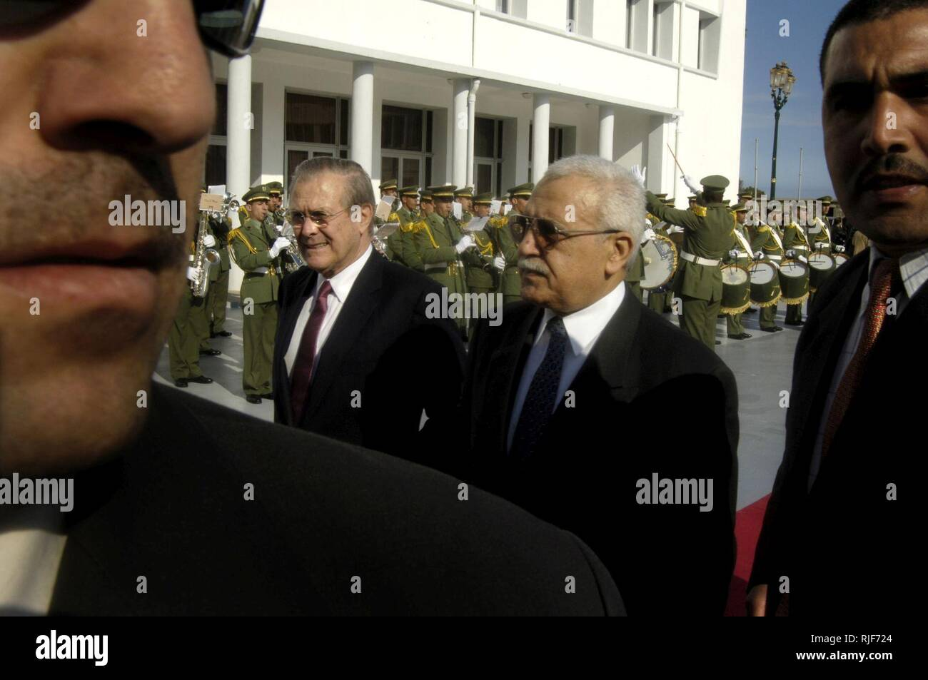 Algerian Minister of Defense Abdelmalek Guenaizia (2nd from right) welcomes Secretary of Defense Donald H. Rumsfeld with full military honors in Algiers, Algeria on Feb. 12, 2006.  Rumsfeld met with delegations from the Mediterranean Dialogue countries of Algeria, Egypt, Israel, Jordan, Mauritania, Morocco and Tunisia earlier at the NATO Ministerial in Taormina, Sicily.  Rumsfeld will meet with Guenaizia and other senior leaders in Algiers to continue those talks and discuss regional security issues. - Stock Image