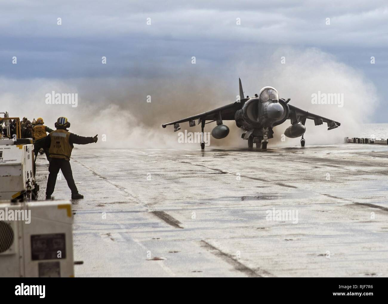 An AV-8B Harrier launches off the flight deck of USS Wasp. (31391542020). Stock Photo