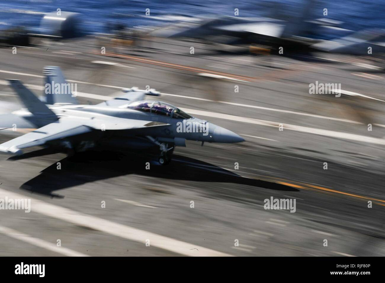 ATLANTIC OCEAN (Jan. 31, 2018) An F/A-18F Super Hornet assigned to the 'Gladiators' of Strike Fighter Squadron (VFA) 106 lands on the flight deck of the Nimitz-class carrier USS Abraham Lincoln (CVN 72). - Stock Image