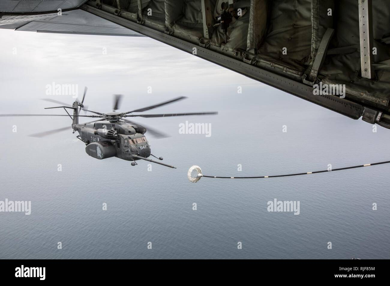 CHERRY POINT, N.C. (June 21, 2017) An  MH-53E Sea Dragon assigned to the 'Vanguards' of Helicopter Mine Countermeasure Squadron (HM) 14 conducts an aerial refuel off the coast of N.C. Marine Aerial Refueler Transport Squadron 252 performed the air to air refueling exercises with HM-14 in a joint effort to improve interservice readiness. - Stock Image