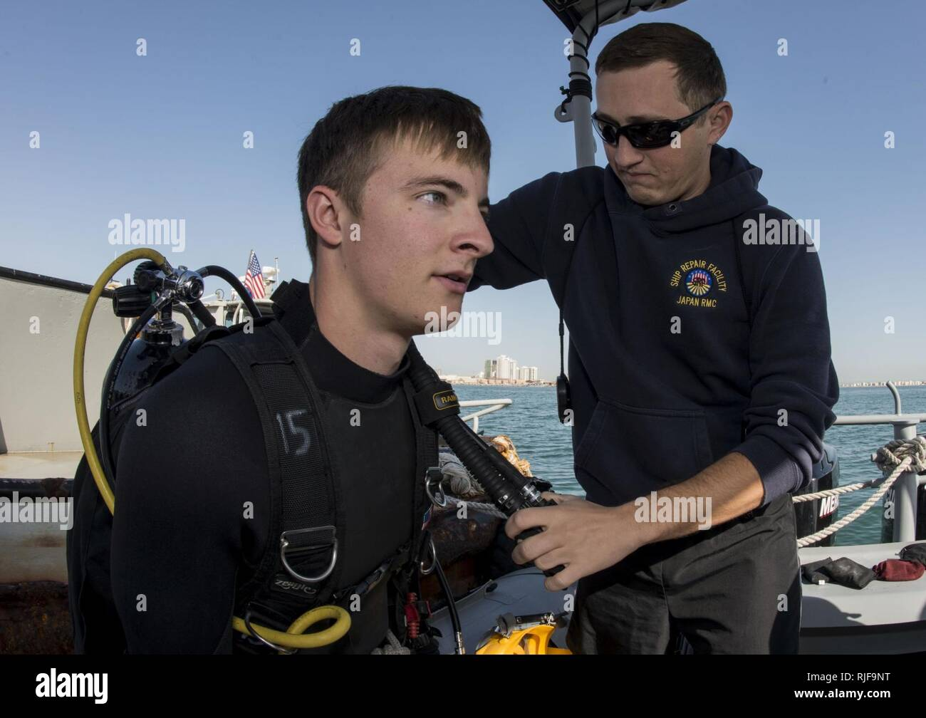 NAVAL SUPPORT ACTIVITY BAHRAIN (Jan. 06, 2016) Navy Diver 1st Class Scott Colvin conducts gear checks on Navy Diver 3rd Class Darren Hauk, assigned to Commander, Task Group (CTG) 56.1, prior to conducting an anti-terrorism force protection dive. CTG 56.1 conducts mine countermeasures, explosive ordnance disposal, salvage-diving and force protection operations throughout the U.S. 5th Fleet area of operations. Stock Photo
