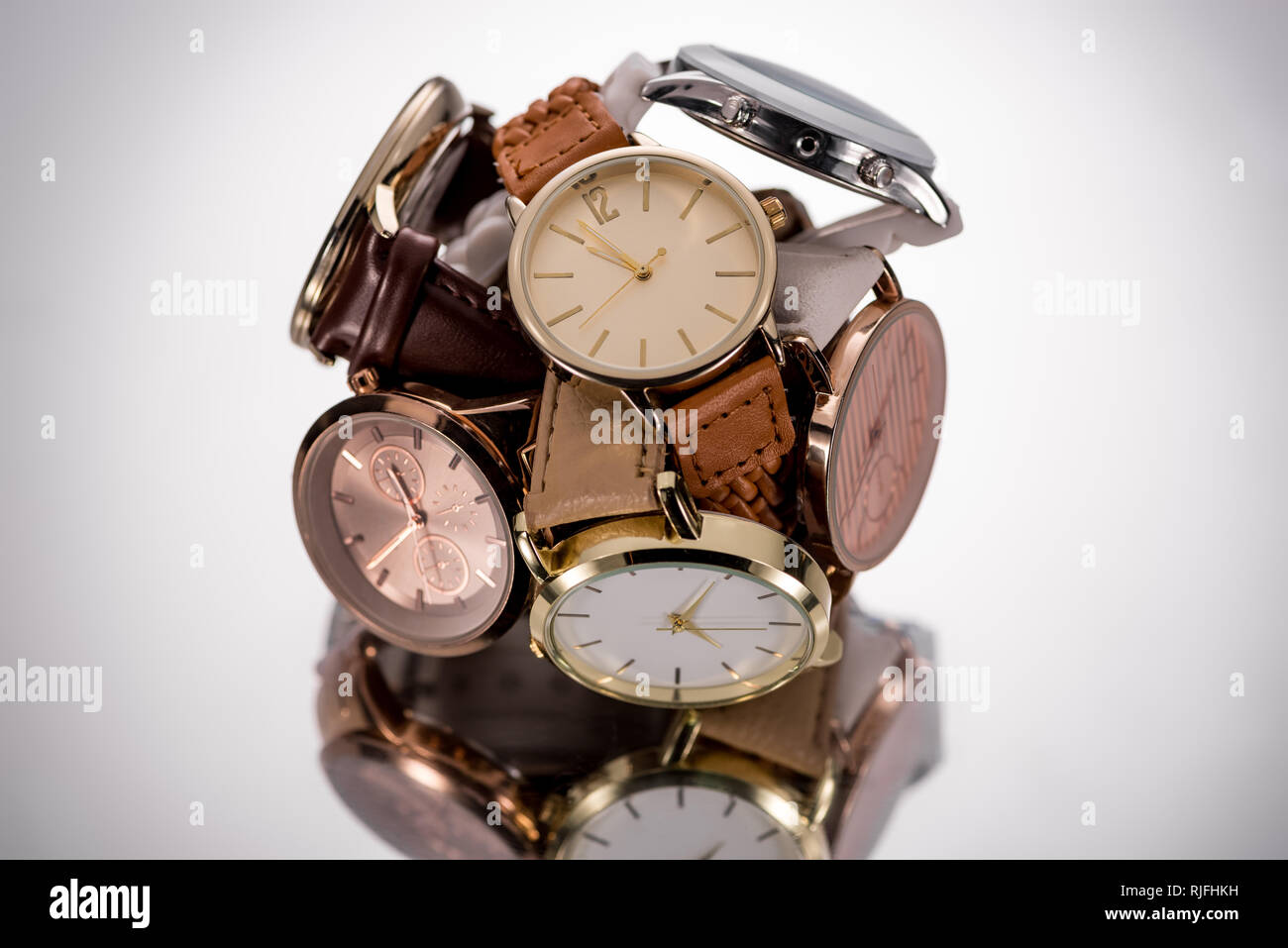 selective focus of swiss wristwatches on grey background - Stock Image