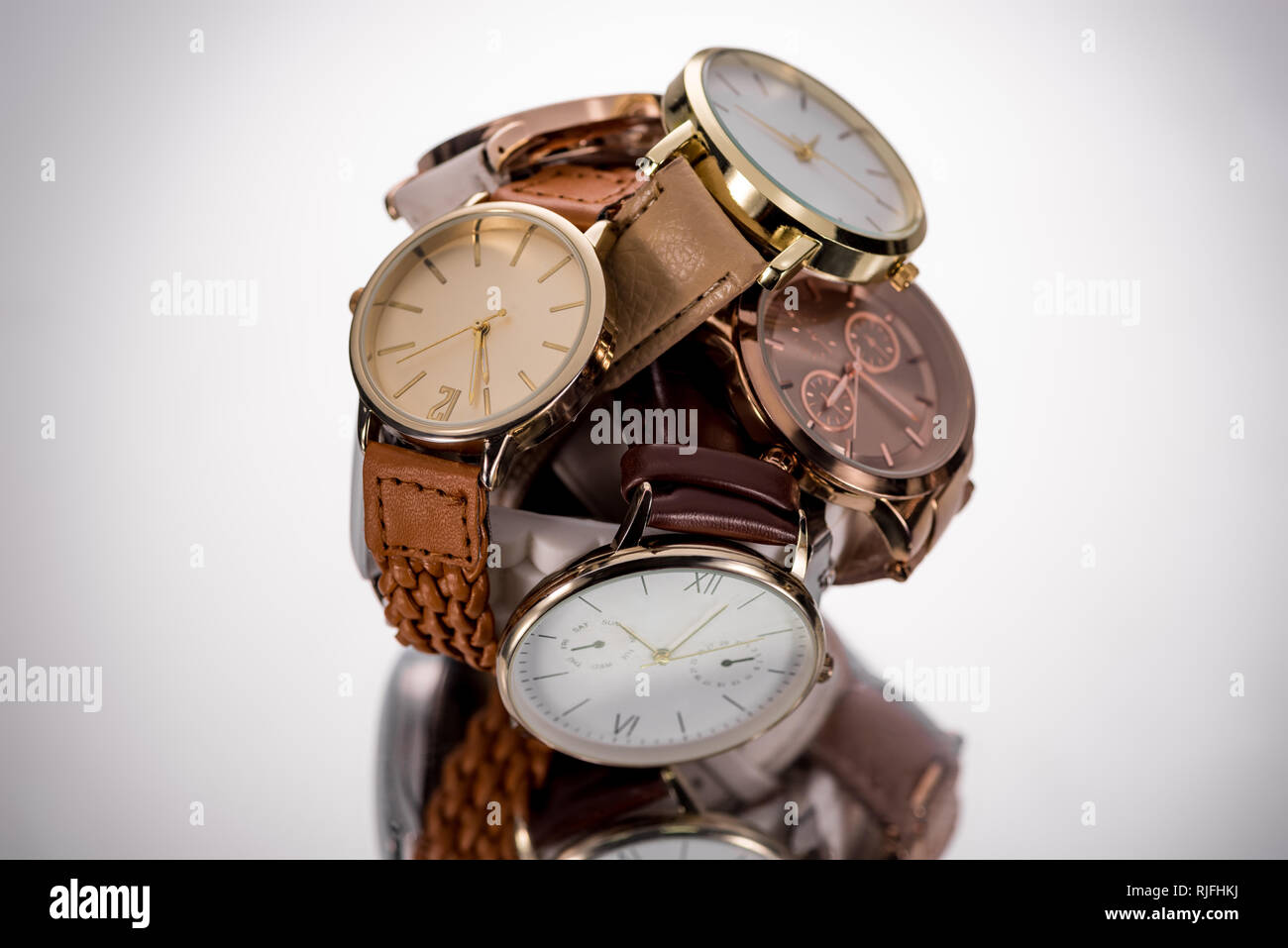 selective focus of elegant wristwatches on grey background - Stock Image