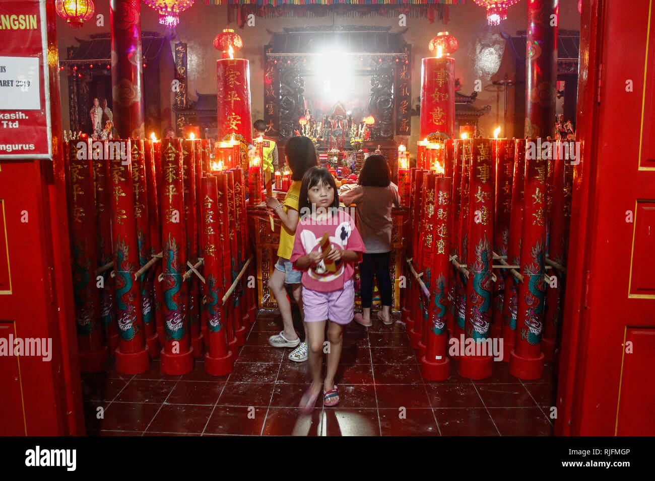 Indonesian Girls From Ethnic Chinese Prays As They Welcoming The