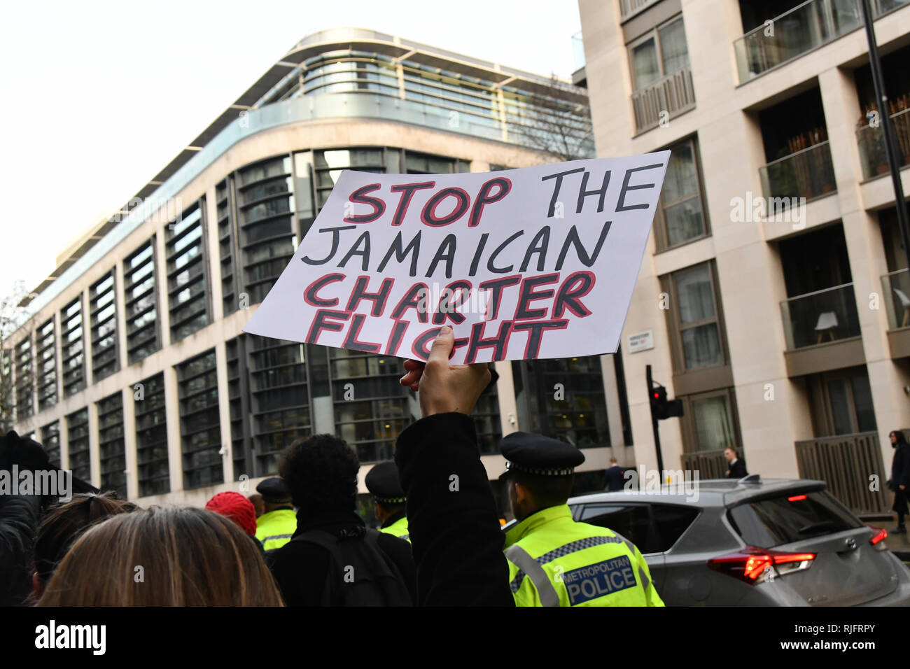 London, UK. 6th February, 2019. Sister Not Cister UK protests demonstration Justice for #Stansted15! Stop the Jamaica Charter Flight! with heavy police present Stop the racist hostile environment drop a banner on Lambeth bridge and march to the Home Office demand to free the #Stansted15 will be Sentencing non-violent peaceful direct action, all of them charged with a terrrorism-related offence that carries a maximum life prison sentence at Chelmsford Crown Court of and Stop deportation, London, UK. 6 Feb 2019. Credit: Picture Capital/Alamy Live News - Stock Image
