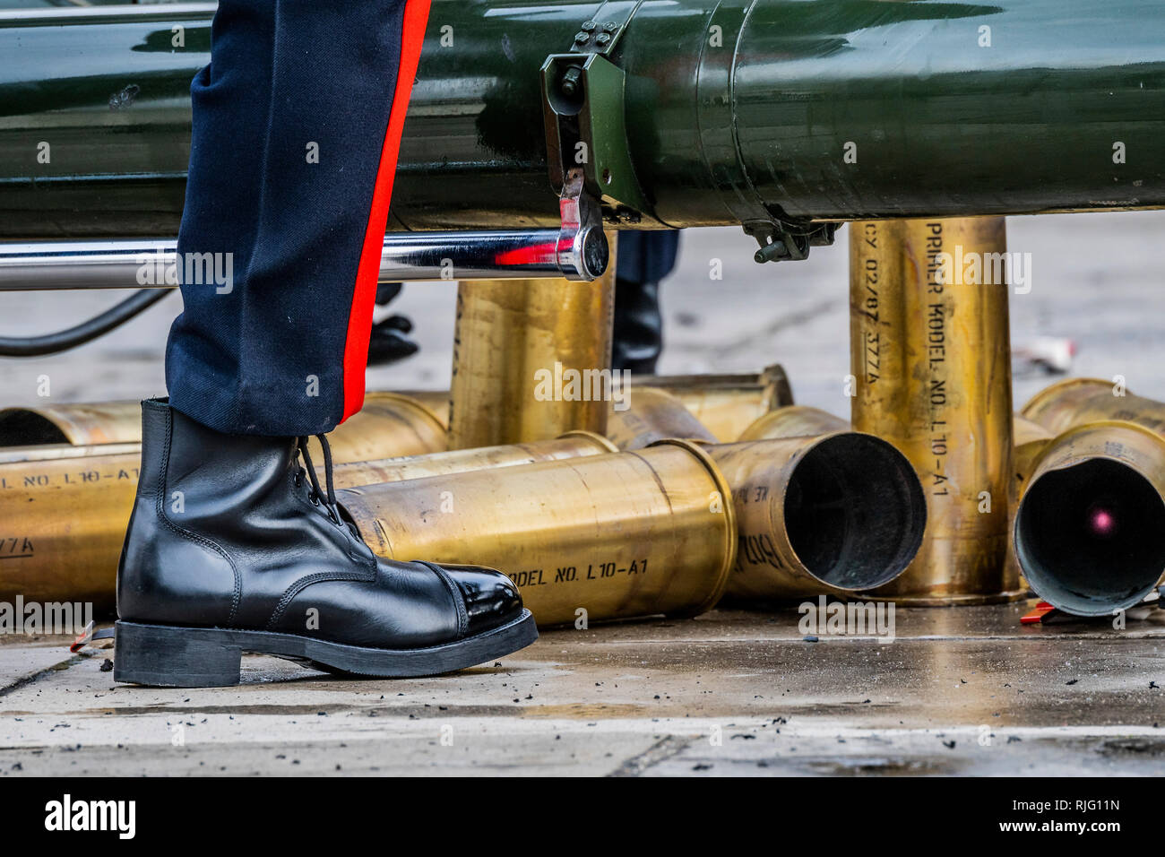 London, UK. 6th Feb 2019. Brass catridge cases after firing - The Honourable Artillery Company (HAC), the City of London's Reserve Army Regiment, fire a 62 Gun Royal Salute at the Tower of London in honour of the mark the 67th anniversary of Her Majesty The Queen's Accession to the Throne . The three L118 Ceremonial Light Guns fired at ten second intervals.  Uniquely, at The Tower of London, a total of 62 rounds are fired on Royal anniversaries as this also includes an additional 21 guns for the citizens Credit: Guy Bell/Alamy Live News - Stock Image