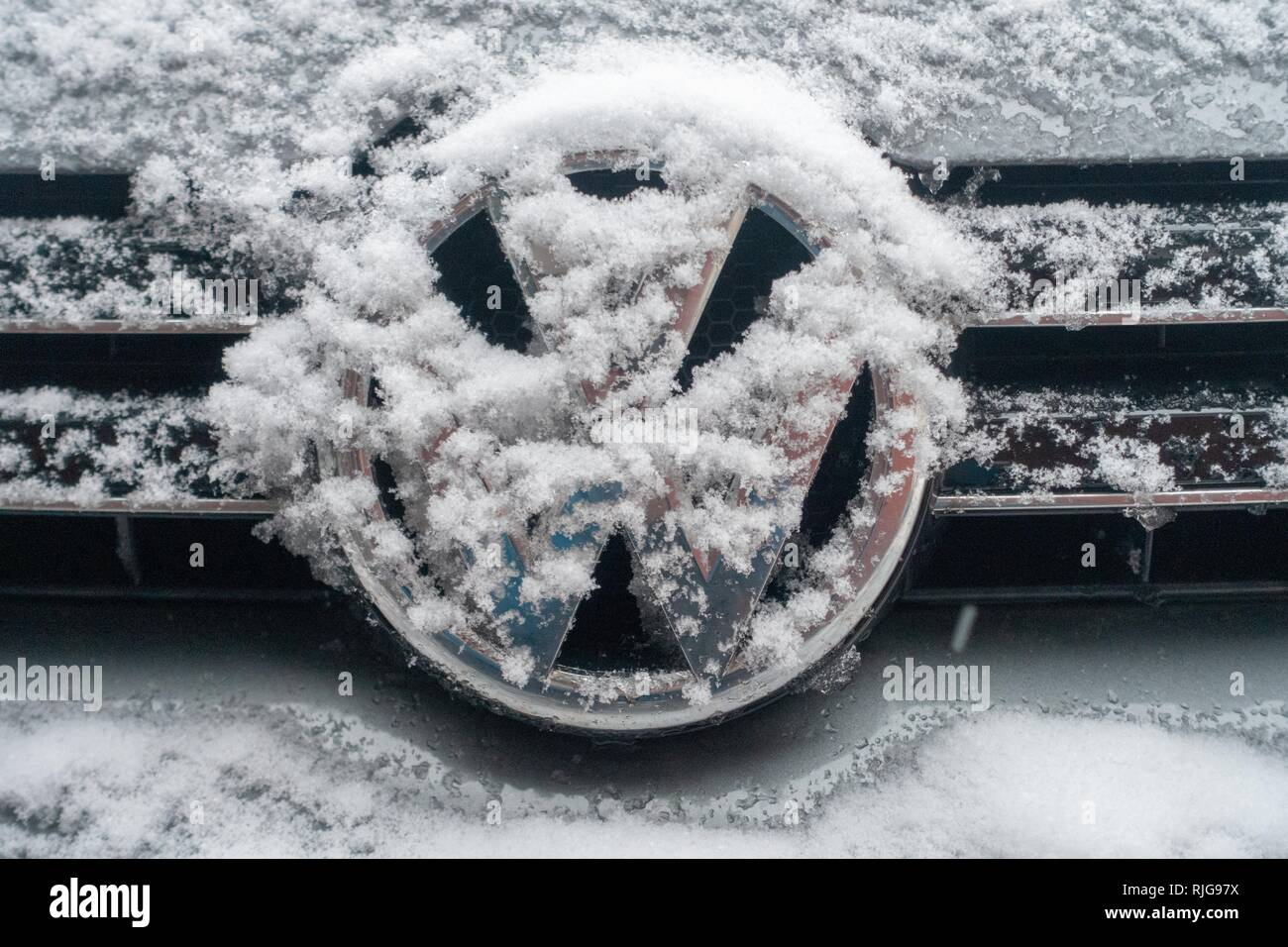 Snow-covered VW logo of VW Golf, Germany - Stock Image