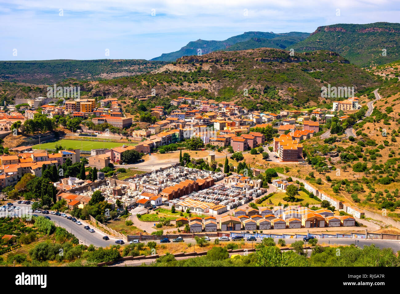 Bosa, Sardinia / Italy - 2018/08/13: Panoramic view of the town of Bosa and surrounding hills seen from Malaspina Castle hill Stock Photo