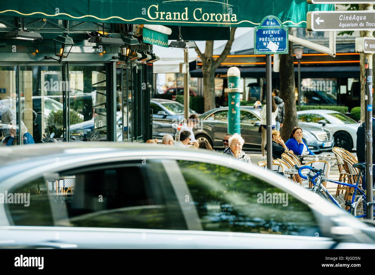 PARIS, FRANCE - MAY 21, 2016: Senior man enjoying cafe and breakfast at Grand Corona Restaurant Paris on a bright morning day - Stock Image