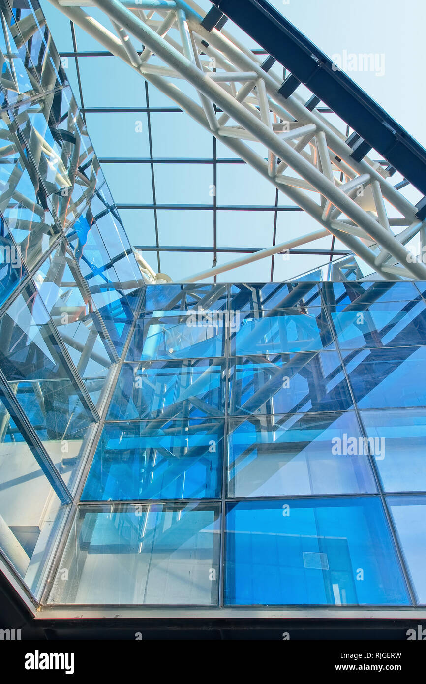 Trendy architecture with blue glass panels in a metal construction - Stock Image