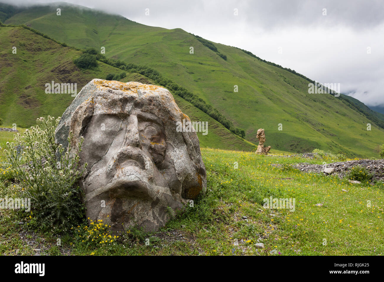 Giant sculptures of famous Georgian minds in the valley of Sno - Stock Image